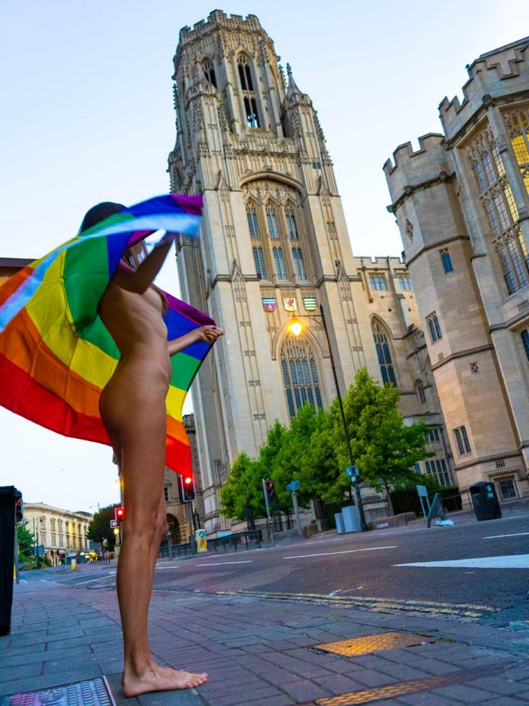 naked girl with rainbow flag in bristol